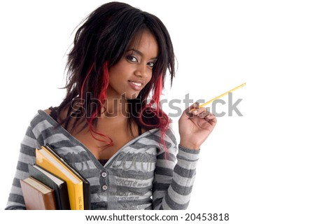 school girl posing with pencil and books on an isolated white background - stock photo