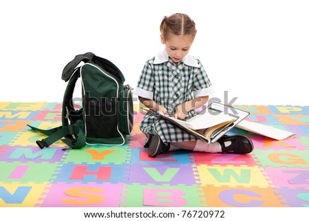 School girl reading school homework book in folder. Isolate on white - stock photo