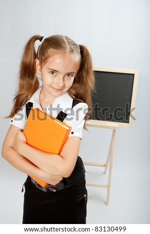 School girl with yellow book - stock photo