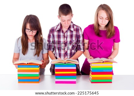 School girls and boy reading and learning from books - stock photo