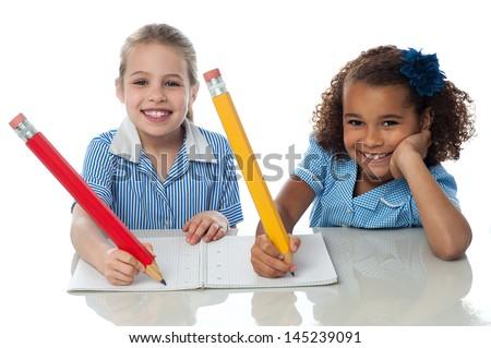 School girls doing homework together - stock photo