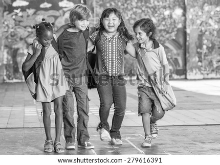 School happiness. Multi racial kids embracing happy. Togetherness concept. - stock photo
