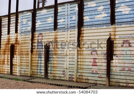 School kid decorations on the US to Mexico border wall in Arizona - stock photo