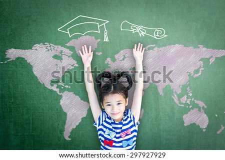 School kid raising hands up with freehand drawing of graduation cap, certificate roll and world map on green chalkboard wishing for educational success: Children education and world literacy concept   - stock photo
