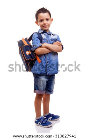 School kid standing with arms crossed on white background - stock photo