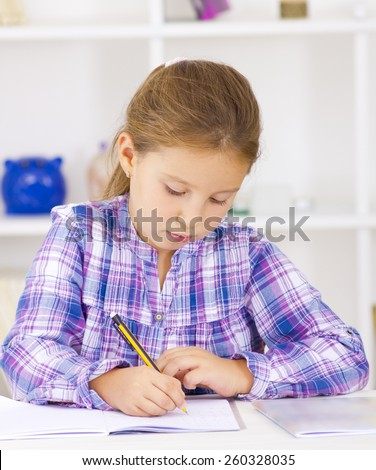 School kid writing homework