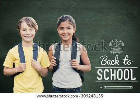 School kids against green chalkboard - stock photo