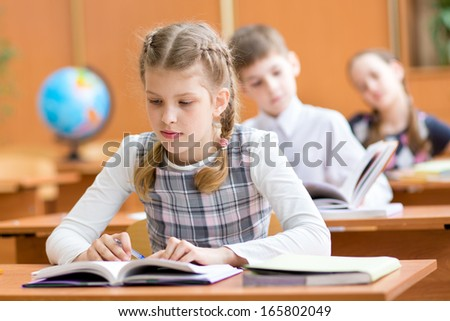 school kids at lesson in classroom - stock photo