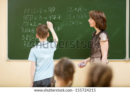 School kids in classroom at math lesson - stock photo