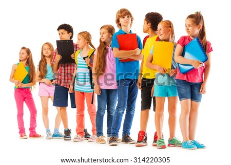 School kids standing in the line with books - stock photo
