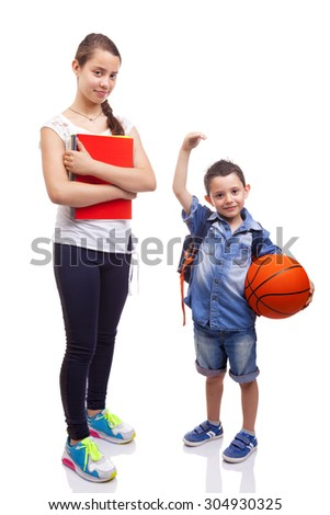 School kids standing on white background - stock photo