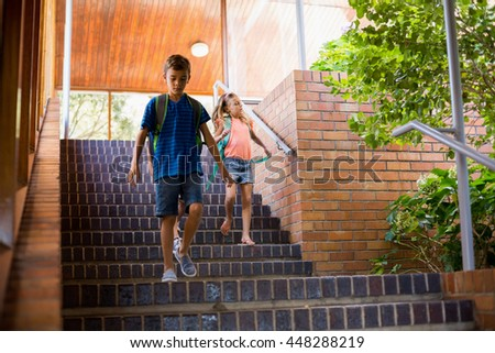 School kids walking on staircase at school - stock photo