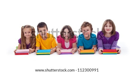 School kids with colorful books smiling in a row - isolated - stock photo