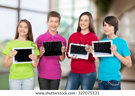 School kids with tablet. - stock photo