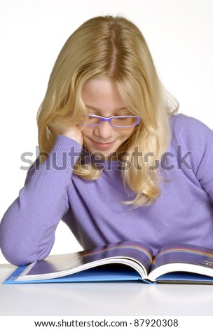 School little girl reading and studding. - stock photo