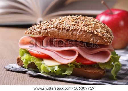 School lunch: a ham sandwich and apple closeup. horizontal  - stock photo