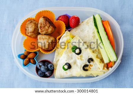 school lunch box for kids with food in the form of funny faces. the toning. selective focus - stock photo