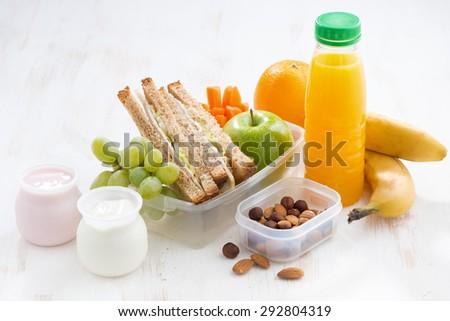 school lunch with sandwiches, fruit and yogurt, horizontal - stock photo