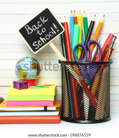 School-office stationery on book background  - stock photo