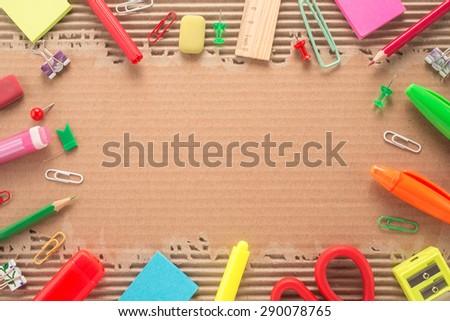 School office supplies on corrugated cardboard - stock photo