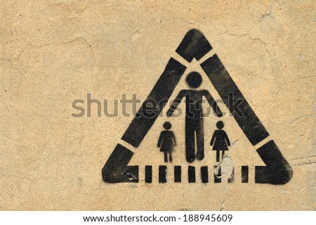 School or children, road sign on the wall - stock photo