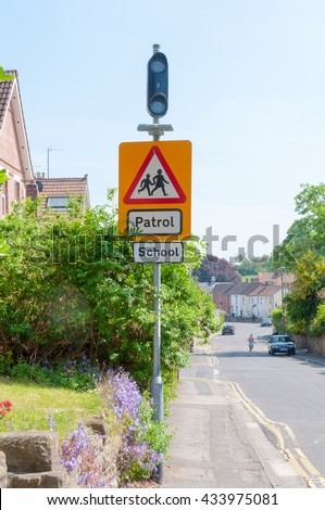 School, Patrol sign, Warning for motorists on a street in England, UK - stock photo
