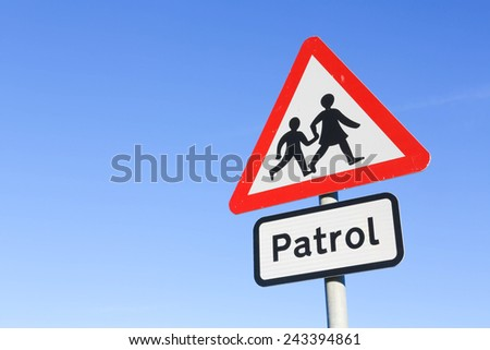 School patrol warning road sign against a clear blue sky background. - stock photo