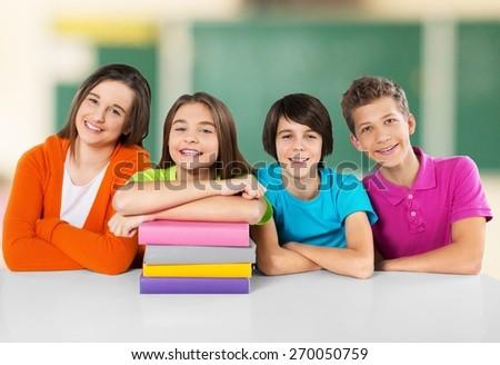 School. Portrait of cheerful school children flashing toothy smiles - stock photo