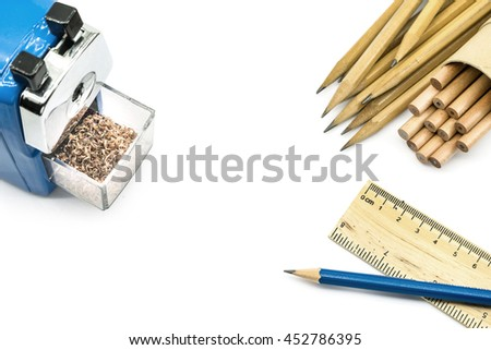 school set with blue pencil sharpener, ruler and pencils on white background - stock photo