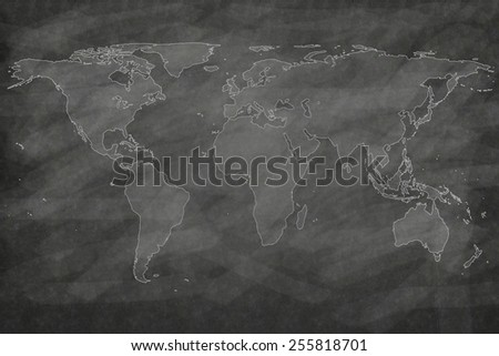 school sketches world map on blackboard - stock photo