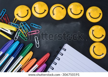 School stationery close up on black board. education,back to school concept. - stock photo