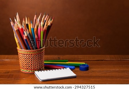 School stationery on wood background.   Back to school concept. - stock photo