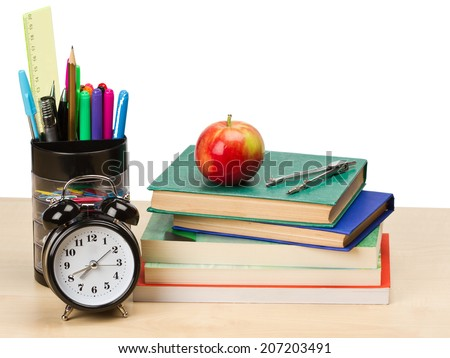 School supplies and alarm clock on table isolated on white - stock photo