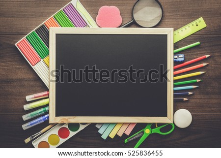 school supplies and blackboard with copy space on table