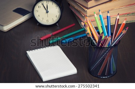 school supplies and notepad for copy space - stock photo