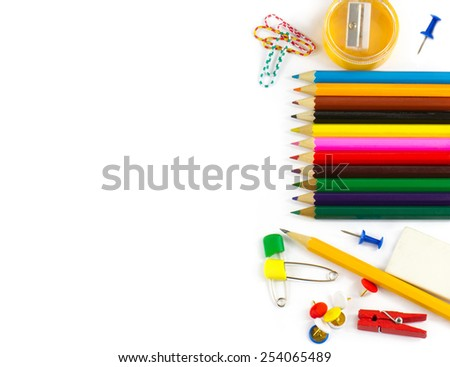 School supplies: colored pencils, paper clips, pencil sharpener, stationery gum, small clothespin, colored pins, pencil isolated on white background