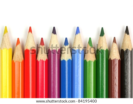 School supplies. Colorful pencils close-up on white background