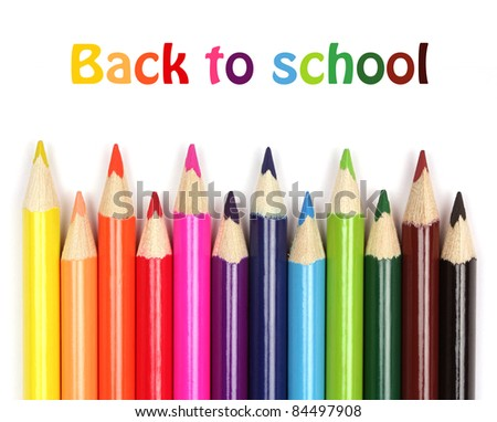 School supplies. Colorful pencils close-up on white background, back to school