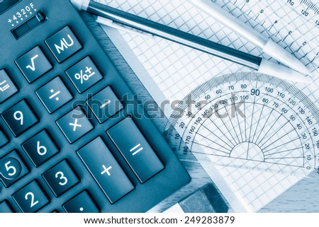 School supplies math geometry and science toned in blue - stock photo