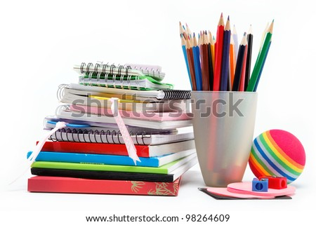 School supplies: notebook, pens, pencils on a white background. - stock photo