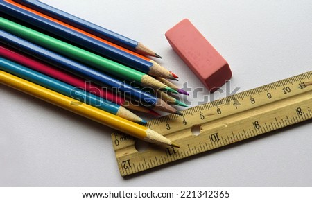 School supplies of pencil crayons, pink eraser and ruler - stock photo