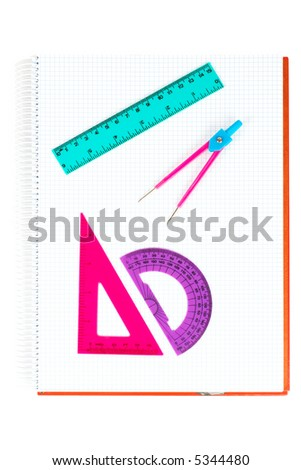 School supplies on a notebook, over white background - stock photo