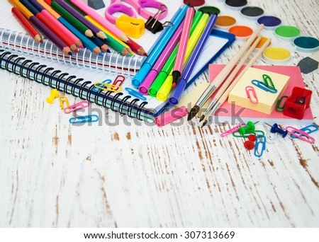 School supplies on a old wooden background