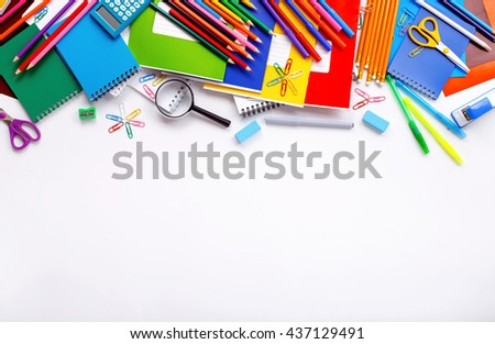 School supplies on a white background with copy space, top view - stock photo