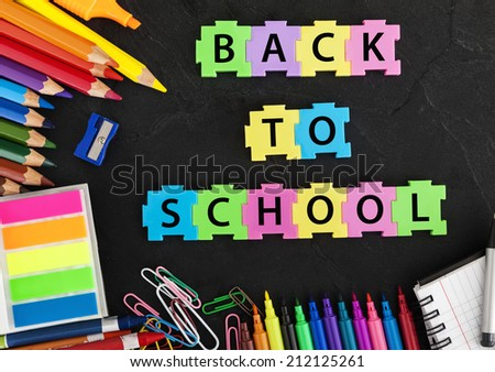 School Supplies On Black Background. - stock photo