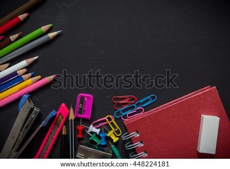 School supplies on blackboard background, View top - stock photo