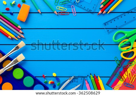 School supplies on blue wooden table - stock photo