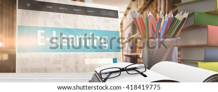 School supplies on desk against close up of a bookshelf - stock photo