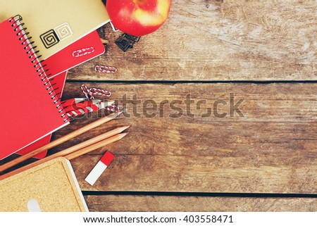 School supplies on old wooden table, close up - stock photo