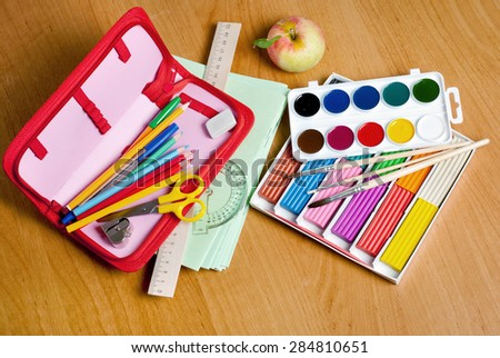 school supplies on the table - stock photo
